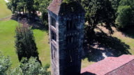 above view of isolated old catholic christian romanesque church with bell tower in nature outdoor scene  4k aerial drone orbit close up sho video