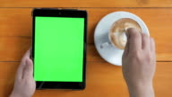 Above view of Using digital tablet,Green screen video