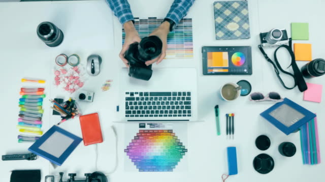 Above view. Photographer working at desk in a creative agency video