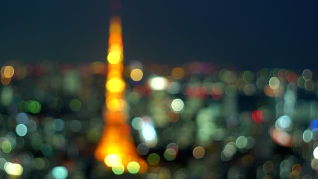 abstract background of tokyo city with tokyo tower illuminated at night video