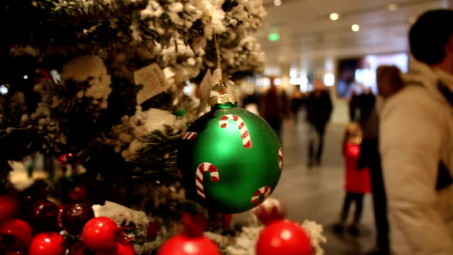 Abstract blurred shopping mall background with Christmas decorations video