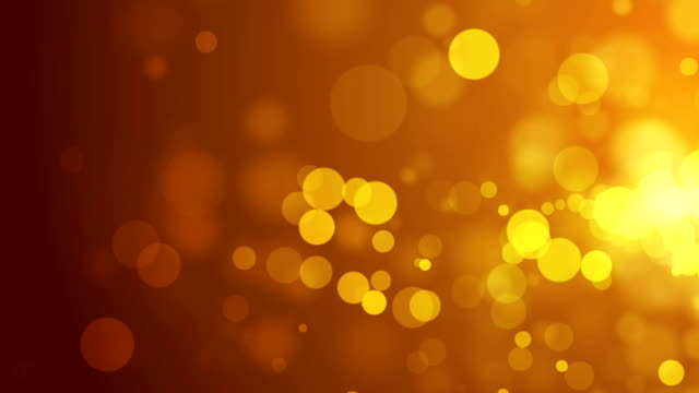 Abstract bokeh golden particles video