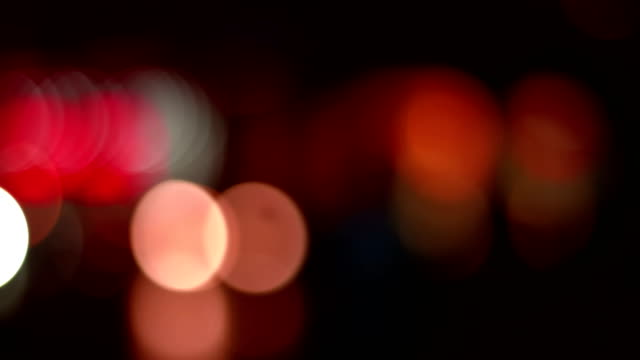 abstract defocused night traffic city lights bokeh background, car lights city nightlife concept video