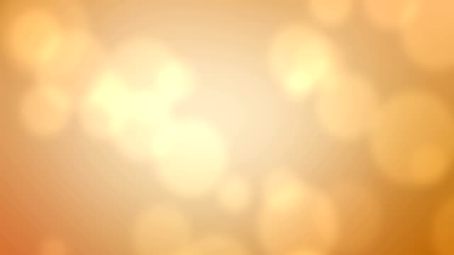 abstract golden sparkle bubbles particles bokeh on golden background, event festive happy new year holiday video