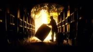 Abstract of vigneron winemaker rolling vintage wine barrel video