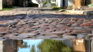 Abstract puddle,cars cobblestone street video