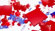 Abstract puzzle pieces in red with message Team video
