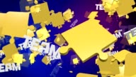 Abstract puzzle pieces in yellow with message Team video