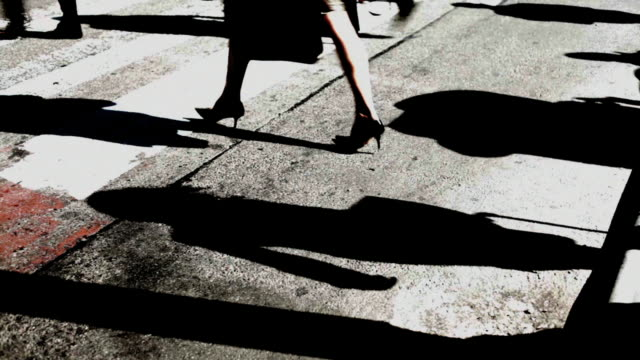 Abstract shadows of people crossing streets video