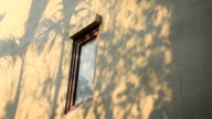 abstract tree leaf shadow in motion on the yellow wall with wooden window video