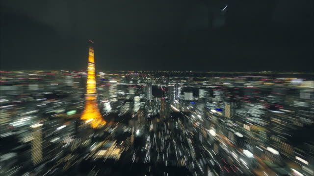 abstract zoom in and out of Tokyo tower with cityscape video