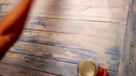 Accelerated footage of a man painting over the wooden board with white paint video