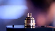 Accepted atomizer from electronic cigarette in a disassembled form closeup video