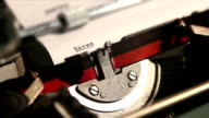 accountant writes the word taxes, with typewriter video