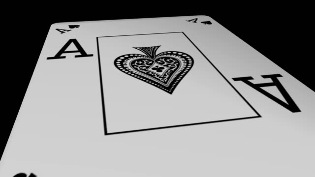 Ace of spades playing card gyrating 360 degree on black background video
