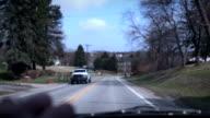 Action movie shot - Car chase POV through fast neighborhood video