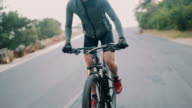 Active adult cyclist ready for the road with all his protective wear video