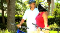 Active Mature Ethnic Couple Cycling for Exercise video
