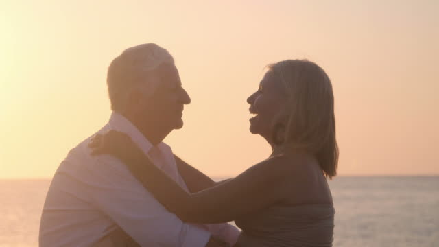 Active retired people, romantic elderly couple in love, kissing video