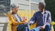 Active Senior African American Couple Enjoying Time Sitting Together Outside video