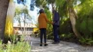 Active Senior African American Couple Walking Through Garden at Home video