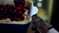 Add cherry to chocolate cake. Cooking cherry cake. Cooking dessert video