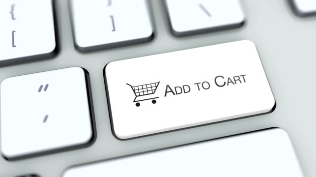 Add to cart button on computer keyboard. Key is pressed. User presses keypad with icon symbol, camera pan, different graphics on keyboard available for download. Using computers contemporary technology, browsing internet pushing buttons. video