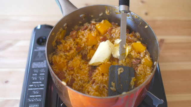 adding butter into butternut squash risotto video
