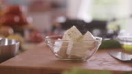 Adding condiment into feta cheese salad video