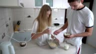 Adding flour, mix with eggs milk and sugar, cooking pancakes video