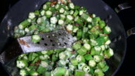 Adding salt and cooking chopped okra video