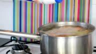 Adding salt to boiling potatoes video