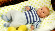 Adorable baby boy lying in crib. video