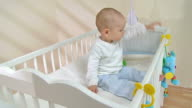 HD: Adorable Baby Boy Sitting In The Crib video