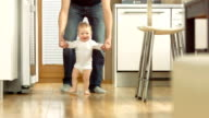 Adorable Baby Taking First Assisted Steps video
