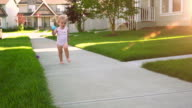 Adorable beautiful little girl in the suburbs video