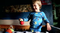 Adorable Blond Kid Playing With Toy Rattle video