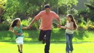 Adorable family runs toward camera video