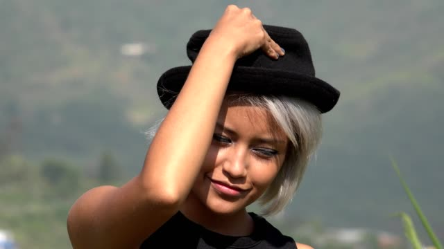 Adorable Female Model Posing With Hat video