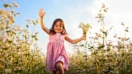 SLO MO Adorable girl running with bunch of flowers video