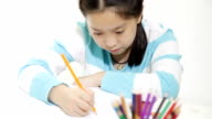 Adorable girl studying in the classroom with concept video