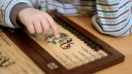 adorable little boy counts the numbers on the dice video