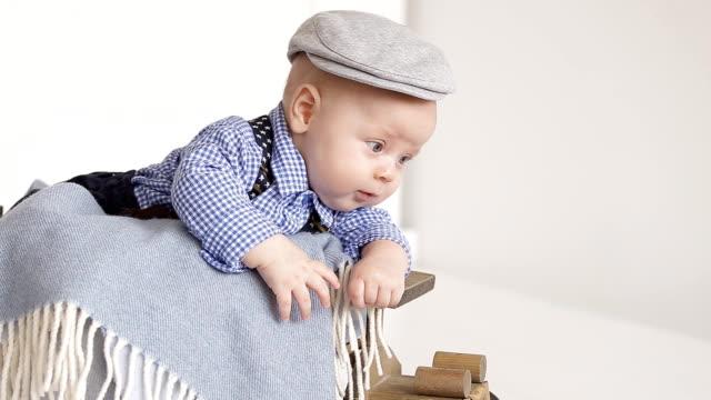 Adorable little boy wearing a gray cap video