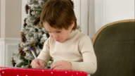 Adorable little boy writing a Christmas wishlist letter to Santa Claus video