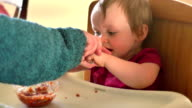 Adorable little girl eats spaghetti for the first time video