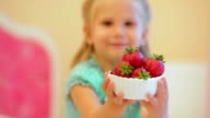 Adorable little girl with strawberries video