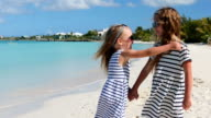 Adorable little girls at beach during summer vacation video