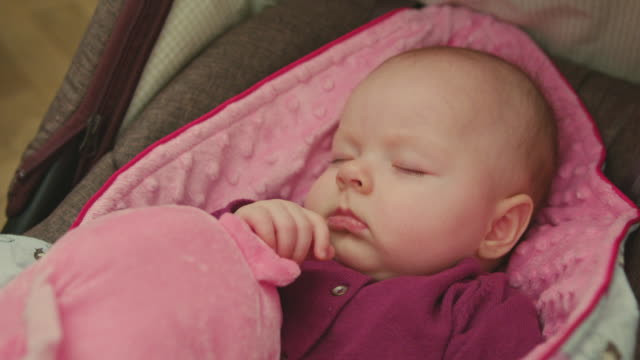Adorable Sleeping Baby on a pink blanket video