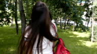 Adorable young girl flirting with the camera and having fun in the park video