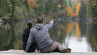 Adult Couple Having Fun On Wooden Dock In Autumn video